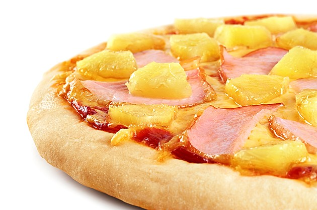 Pizza with pineapple and ham on white background. Close up.
